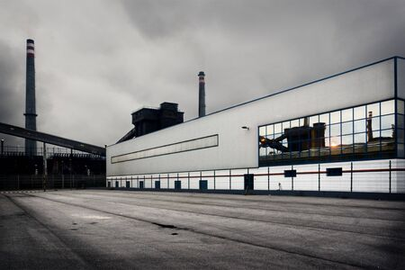 destined: Industrial ship. To the bottom and reflected in its window there is seen part of the facilities of batteries for the obtaining of coke destined to the high ovens of manufacture of steel. The gray sky and the develop emphasize the dirt and local pollution