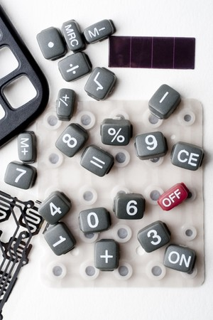 Circuit framework and keys of a calculator disarmed on white background Standard-Bild