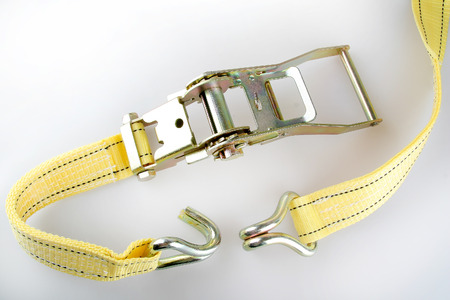 duty belt: Ratchet truck cargo tie downs on white backrounds Stock Photo