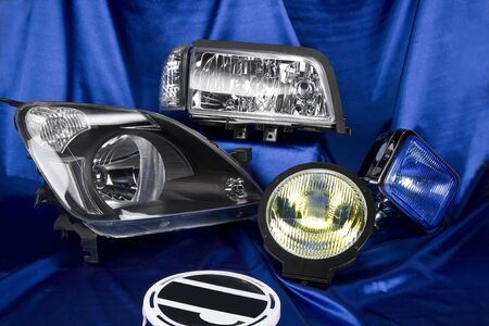 the traffic movement police: Car lights and car headlamp on blue background
