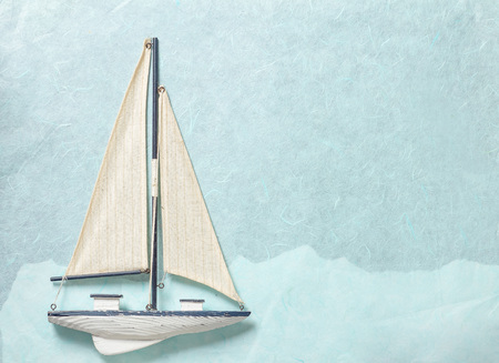 Sailing Yacht on light blue paper background 스톡 콘텐츠