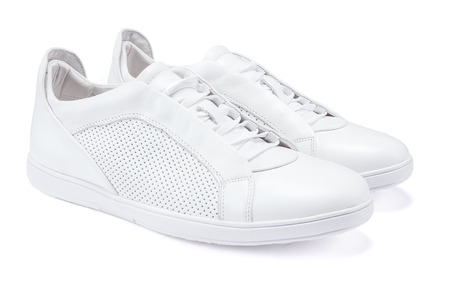 Pair of new white sneakers on white background Banque d'images