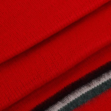 Texture de foulard de couleur rouge. fleur faite par écharpe.