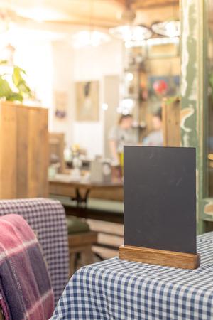 Mock up Menu frame standing on table in Bar restaurant cafe.