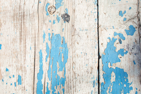 cracked horizontal wooden panel with peeling blue paint