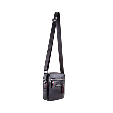 Modern men leather handbag black color with adjustable woven shoulder strap isolated
