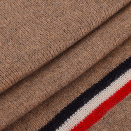 Close-up mens scarf in paster brown fabric with blue strips and folds