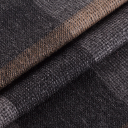 Close-up mens scarf in paster brown fabric with blue strips and folds, for background or texture Reklamní fotografie