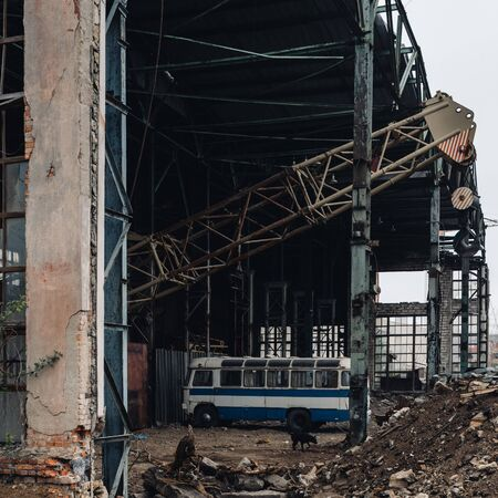 Ruins of industrial enterprise, dark debris destroyed factory premises 版權商用圖片