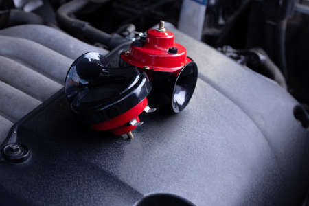 Red air horn for a car on a car engine. Electric Car air horn. 版權商用圖片