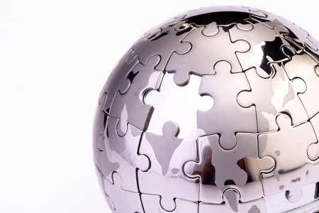 Metal puzzle globe isolated on white background  photo