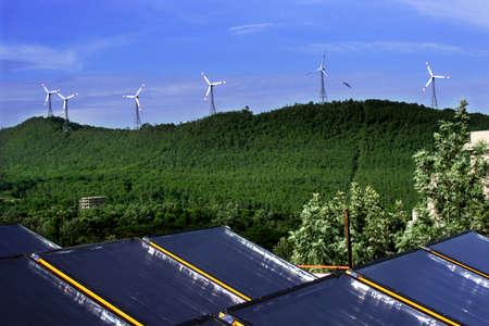 benign: Environmentally benign solar panels and wind turbines generating electricity  Stock Photo