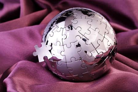 Puzzel wereldbol Stockfoto