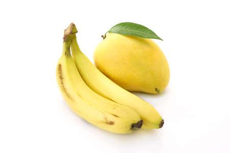 Organic mango and bananas on white photo