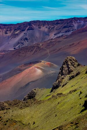Colorful view of a volcanic cone from the valley of the Haleakala Crater in Maui, Hawaii Stock Photo