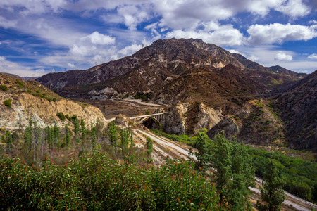 View of The Bridge to Nowhere set against the San Gabriel Mountains in Angeles National Forest, California Stock Photo