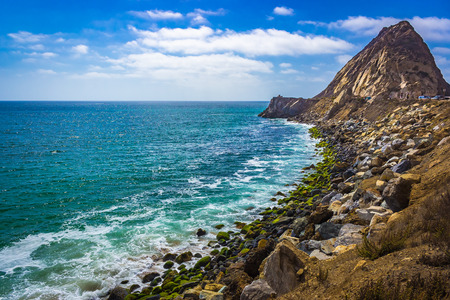 Rocky shoreline view of the Point Mugu Rock along Pacific Coast Highway, Point Mugu, California Stock fotó