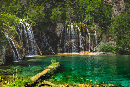 Peaceful waterfalls and clear green water at Hanging Lake, Glenwood Canyon, Colorado