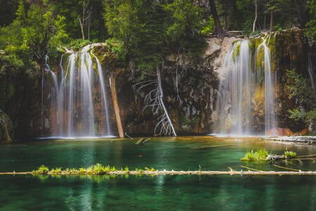 Serene Waterfalls and clear green water at Hanging Lake, Glenwood Canyon, Colorado