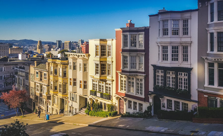 View of colorful San Francisco row homes looking down a steep city street