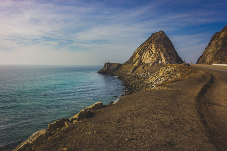Rocky shoreline view of the Point Mugu Rock along Pacific Coast Highway, Point Mugu, California Stock Photo