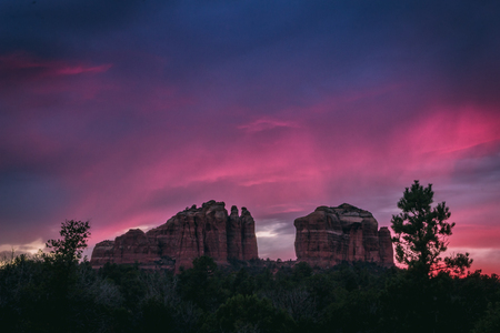 Beautiful Cathedral Rock formation with dramatic pink and purple sky at sunset, Sedona, Arizona