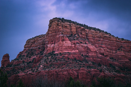 Majestic red rock formations at blue hour with dramatic clouds in the sky, Coconino National Forest, Arizona