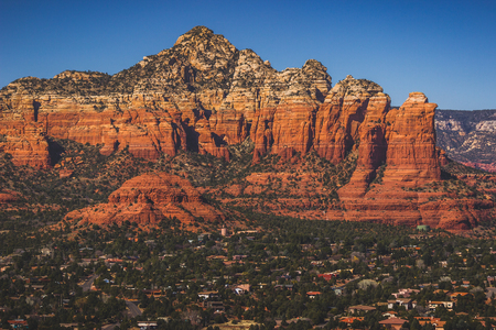 Famous Coffee Pot Rock and Sugarloaf Mountain red rock formations standing high above West Sedona, Arizona Stock Photo