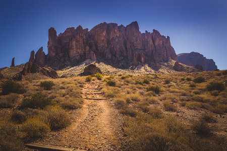 Iconic view of Superstition Mountains and Saguaro cacti in Lost Dutchman State Park, Arizona from Treasure Loop Trail Stock Photo