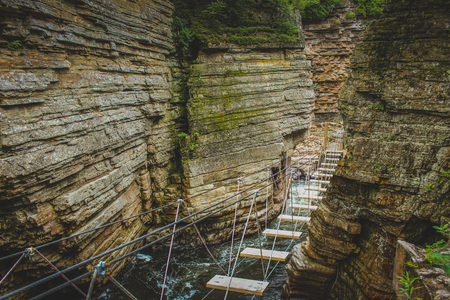 Adventurous rope bridge over Ausable River seen at Ausable Chasm tourist attraction near Keeseville, New York, United States Banco de Imagens