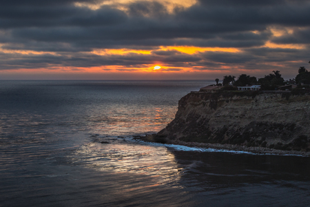 Colorful, long-exposure, elevated view of Lunada Bay with waves crashing onto the shore at sunset, Palos Verdes Estates, California