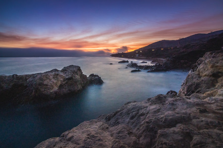 Colorful coastal view of Leo Carrillo State Beach after sunset from Sequit Point, Malibu, California