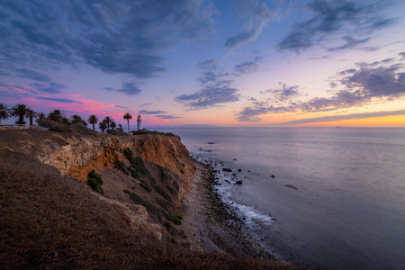 Colorful sky and coastal view of Point Vicente Lighthouse atop the steep cliffs of Rancho Palos Verdes, California after sunset