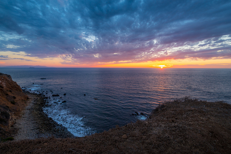 Beautiful coastal view of Point Vicente Lighthouse atop the steep cliffs of Rancho Palos Verdes, California at sunset