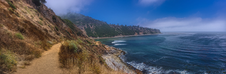 Colorful coastal view of Bluff Cove covered with a marine layer near the rocky shores of Flat Rock Point, Palos Verdes Estates, California Imagens