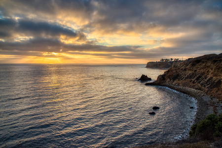 Colorful coastal view of Pelican Cove and Point Vicente Lighthouse with dramatic sky at sunset from Terranea Trail, Rancho Palos Verdes, California Imagens