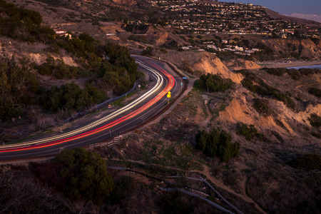 Long exposure photo of light streaks from cars driving along coastal Palos Verdes Drive, Rancho Palos Verdes, California