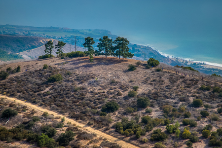 Elevated view of Eagles Nest Trail and scenic overlook of Portuguese Canyon with California coast in the distance, Rancho Palos Verdes, California