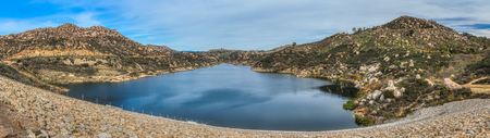 Beautiful Lake Ramona surrounded by mountains in an elevated location seen from the Green Valley Truck Trail, Blue Sky Ecological Reserve, Poway, California