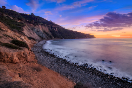 Long exposure photo of Southern California coastline after sunset with dramatic clouds in the sky, Bluff Cove, Palos Verdes Estates, California Imagens