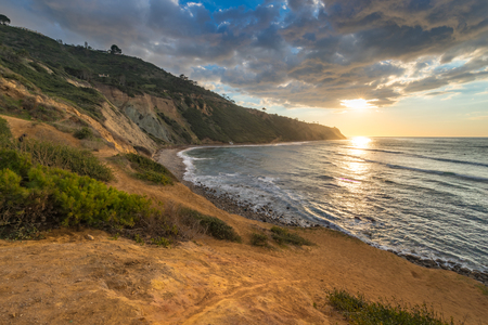 Scenic overlook of Southern California coastline at sunset with dramatic clouds in the sky, Bluff Cove, Palos Verdes Estates, California