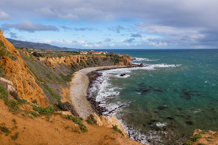 Breathtaking coastal view of Pelican Cove cliffs on a sunny day with blue and turquoise water, Rancho Palos Verdes, California
