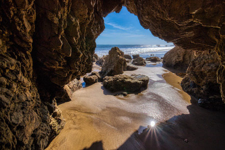 Beautiful rock arch with a view of the ocean at the popular El Matador Beach along the Southern California coast, Malibu, California