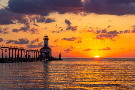 Stunning sunset with dramatic clouds over Michigan City East Pierhead Lighthouse, Washington Park Beach, Michigan City, Indiana