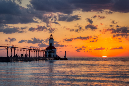Stunning sunset with dramatic clouds over Michigan City East Pierhead Lighthouse, Washington Park Beach, Michigan City, Indiana Reklamní fotografie