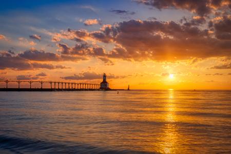 Stunning sunset with dramatic clouds over Michigan City East Pierhead Lighthouse, Washington Park Beach, Michigan City, Indiana