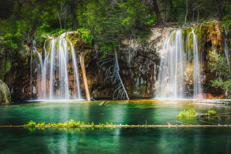 Serene Waterfalls and clear green water at Hanging Lake, Glenwood Canyon, Colorado Stock Photo