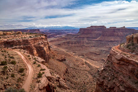 Spectacular view of rugged Shafer Trail winding down into Shafer Canyon on an overcast day, Shafer Canyon Overlook, Island in the Sky District, Canyonlands National Park, Moab, Utah