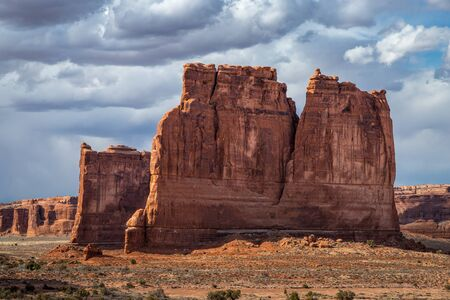 Beautiful view of The Organ sandstone rock structure with Tower of Babel behind it, seen along Arches Scenic Drive, Arches National Park, Moab, Utah