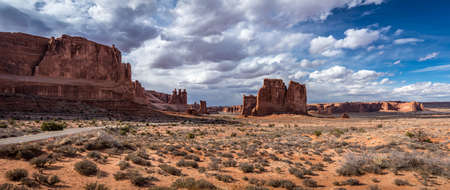 Scenic overlook of towering sandstone giants seen along Arches Scenic Drive near the Park Avenue section of Arches National Park, Moab, Utah